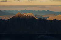 Last light shines across distant mountain peaks, Lofoten Islands, Norway