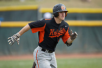 Austin Beck (23) of the North Davidson Knights hustles down the first base line during the game against the Alexander Central Cougars at Bob Gryder Stadium on March 25, 2017 in Taylorsville, North Carolina.  The Knights defeated the Cougars 3-0.  (Brian Westerholt/Four Seam Images)