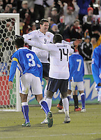 U.S. forward Kenny Cooper (9) celebrates his opening goal with Jozy Altidore (14). The U.S. Men's National Team defeated Guatemala 2-0 in the final game of the semi-final round of qualifying for the 2010 FIFA World Cup. Dick's Sporting Goods Park, Denver, Colorado. November 19, 2008. Photo by Trent Davol/isiphotos.com.