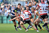 Ollie Devoto of Bath Rugby takes on the Gloucester defence. West Country Challenge Cup match, between Bath Rugby and Gloucester Rugby on September 26, 2015 at the Recreation Ground in Bath, England. Photo by: Patrick Khachfe / Onside Images