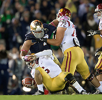 Stephon Tuitt (7) sacks USC Trojans quarterback Cody Kessler (6) in the fourth quarter.