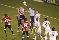 DC United's goalkeeper Louis Crayton punches the ball away from attacking Chivas USA forward Justin Braun. The DC United and Chivas USA played to a 2-2 tie at Home Depot Center stadium in Carson, California on Saturday May 16, 2009.   .