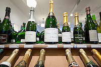 Bottles of champagne wine on display at Chambers Street Wines in New York, NY, USA, 22 May 2009. The store specializes in naturally made wines from artisanal small producers and has received a Slow Food NYC Snail of Approval.