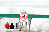 Sign indicating the skating season on the L'Assomption is over because of warmer than normal temparatures.