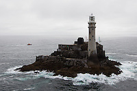 IRELAND, Fastnet Rock. 2nd July 2012. Volvo Ocean Race, Leg 9, Lorient to Galway. Camper with Emirates Team New Zealand (left) and Groupama Sailing Team approach the Fastnet Rock.