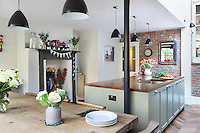 Kally Ellis's cheerful kitchen extension, decorated with colourful flower arrangements