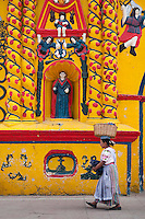 Quetzaltenango, Guatemala, March 2012. The highly decorated bright yellow church of San Andres Xecul in Totonicapan.  Quetzaltenango, also known as Xela, its mayan name, is the base to explore the surrounding traditional maya villages and the Santiaguito volcano. Guatemala is a great country to experiencce the Mayan lifestyle and see the ruins of ancient cultures. Photo by Frits Meyst/Adventure4ever.com