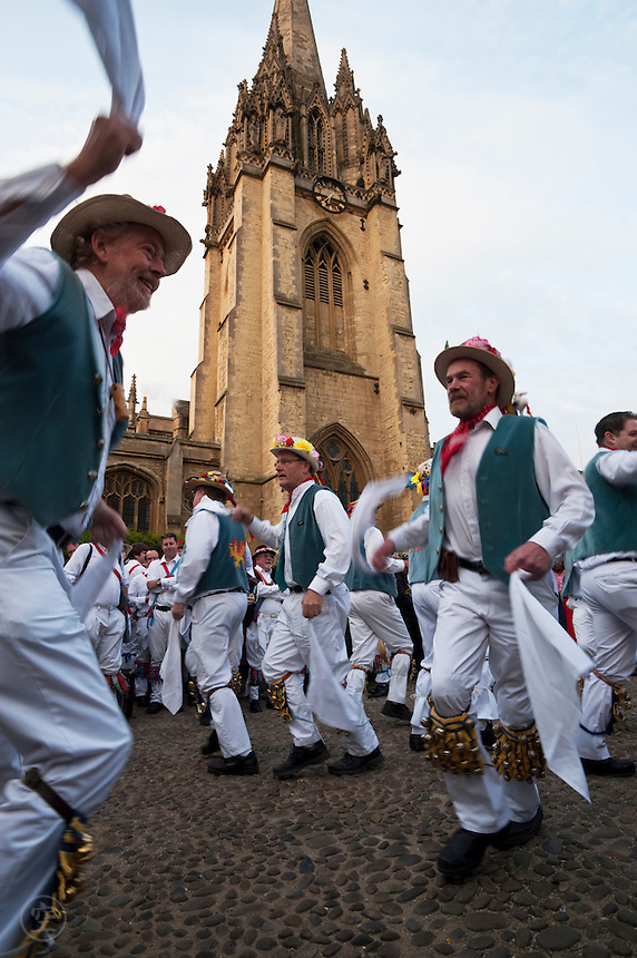 Morris dancers celebrate May Morning in front of the St. Mary's Church tower in Oxford.