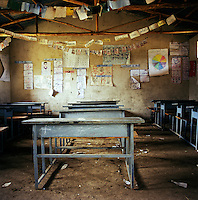 A Grade 2 classroom in Chimbiri school, which is one of the best, with one desk available for every four students. Although primary education is compulsory in Ethiopia, and free in government-run schools, pupils have to pay for their textbooks and uniforms and in many rural areas schools simply do not exist...