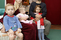 A Chechen man with his wife and three daughters in the URiC Wola Center in Warsaw..The family house in Grozny was demolished by Russian bombes during the first conflict in 1995. He has rebuild the house in 1996. The house was bombed again at the beginning of the second conflict in 1999. In 2004, after five years of surviving in  destroyed Chechen capital, all the family took the exile road to Poland..-For security reason, the face of the adult asylum seeker have been evicted of the photography..-For security reason, the names of the adult asylum seeker have been change. .-Article 9 of the Act of 13 June 2003 on grating protection on the Polish territory (Journal of Laws, No 128, it. 1176) personal data of refugees are an object of particular protection..-Cases where publication of a picture or name of asylum seeker had dramatic consequences for this persons and is family back in Chechnya. .Please have safety of those people in mind. Thank you.