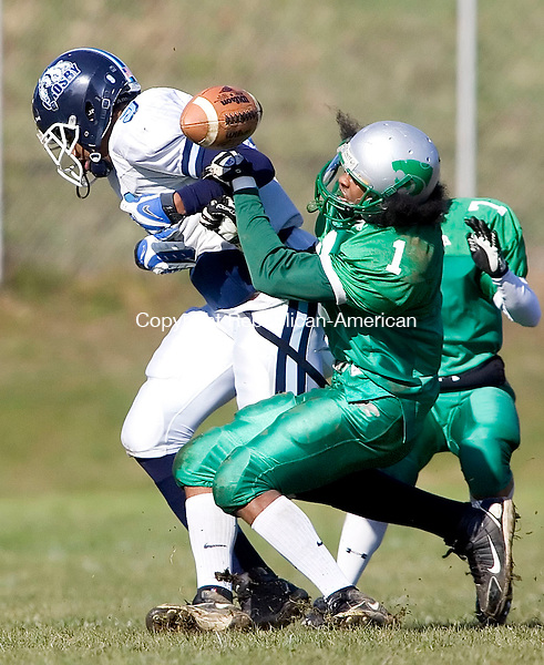 WATERBURY, CT- 10 NOV 2007- 111007JT13- <br /> Crosby's Jerome Cunningham loses the ball as gets tackled by Wilby's Dwayne Bennett during Saturday's game at Wilby. Crosby won 47-14.<br /> Josalee Thrift / Republican-American