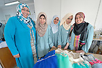 Teacher Ayda el-Habbash poses with some of her students in an advanced dressmaking class in the Vocational Training Center in Gaza City, Gaza. The center is sponsored by the Department of Service for Palestinian Refugees of the Near East Council of Churches, and funded in part by the Pontifical Mission for Palestine. DSPR is a member of the ACT Alliance.