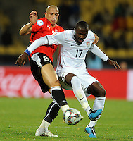 Jozy Altidore (17) of USA and Wael Gomaa (left) of Egypt. USA defeated Egypt 3-0 during the FIFA Confederations Cup at Royal Bafokeng Stadium in Rustenberg, South Africa on June 21, 2009.