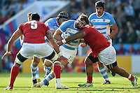 Juan Martin Fernandez Lobbe of Argentina takes on the Tonga defence. Rugby World Cup Pool C match between Argentina and Tonga on October 4, 2015 at Leicester City Stadium in Leicester, England. Photo by: Patrick Khachfe / Onside Images