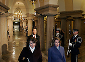 Washington, DC - Barack Obama is escorted through the United States Capitol By United States Senator Dianne Feinstein (Democrat of Cslifornia), left, and Speaker of the United States House Nancy Pelosi (Democrat of California), right, during the Inaugural ceremonies on Tuesday, January 20, 2009..Credit: Pool via CNP