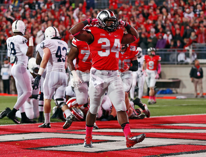 Ohio State Buckeyes running back Carlos Hyde (34) celebrates scoring a touchdown during the first quarter of the NCAA football game  against Penn State at Ohio Stadium in Columbus on Oct. 26, 2013. (Adam Cairns / The Columbus Dispatch)