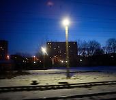 LODZ, FEBRUARY 2012:.View of sleeping town at 4:30 from train to Warsaw. About 500 thousand people commute everyday from other towns and villages to work in the Polish capital..(Photo by Piotr Malecki / Napo Images)..Lodz, Luty 2012:.Widok z pociagu do Warszawy o 4:30 rano. Okolo 500 tysiecy osob dojezdza codziennie z innych miast do pracy w Warszawie.  .Fot: Piotr Malecki / Napo Images