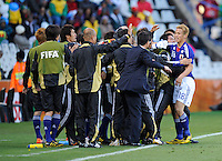 Keisuke Honda of Japan celebrates his goal with team-mates
