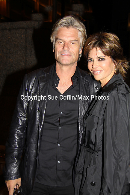 Days of Our Lives Lisa Rinna and husband Harry Hamlin return to their hotel in New York City, New York on October 6, 2010 after signing their new books at Bookends in Ridgewood, New Jersey. Their new reality show Harry Loves Lisa started airing on TVLand tonight. (Photo by Sue Coflin/Max Photos)