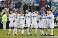 Akron Zips players stand arm in arm during the penalty kick shootout. The Virginia Cavaliers defeated the Akron Zips 3-2 in a penalty kick shoot out after a scoreless game and overtime in the finals of the 2009 NCAA Men's College Cup at WakeMed Soccer Park in Cary, NC on December 13, 2009.