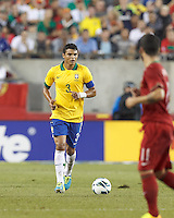 Brazil defender Thiago Silva (3) brings the ball forward.  In an international friendly, Brazil (yellow/blue) defeated Portugal (red), 3-1, at Gillette Stadium on September 10, 2013.