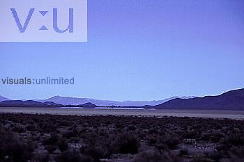 Dry lake and a mirage, Mojave Desert, California, USA.