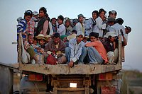 Workers are transported atop a truck after finishing work at a construction site in capital Naypyitaw January 24, 2012. Hopes of concrete economic reforms, backed by the resumption of activities by multilateral lenders such as the Asian Development Bank are high among the foreign business people now pouring into Myanmar two months after U.S. Secretary of State Hillary Clinton's landmark visit. Few argue against Myanmar's potential. As big as France and Britain combined, the resource-rich country sits strategically between India, China and Southeast Asia with ports on the Indian Ocean and Andaman Sea, all of which have made it a coveted energy security asset for Beijing's western provinces.   REUTERS/Damir Sagolj (MYANMAR)