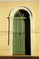 Door with pilasters or pilastres in the Spanish colonial town of Todos Santos , Baja California Sur, Mexico