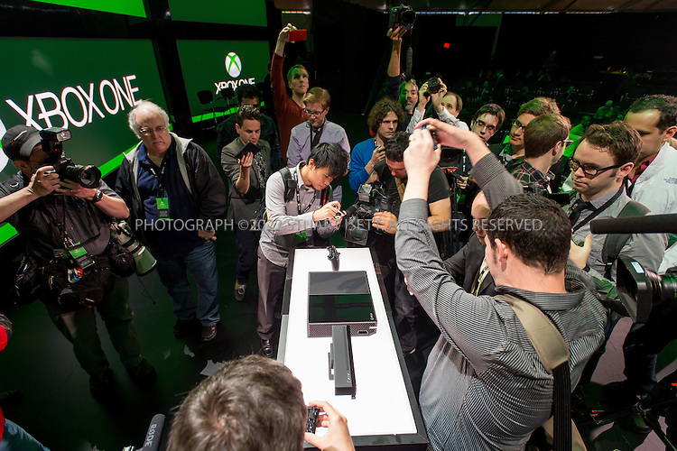 5/21/2013--Redmond, WA, USA..At Microsoft's Redmond Campus in WASH., the company unveiled it's next generation XBox gaming system, the XBox One. The console's new features include voice command, cloud integration, universal gestures and the familiar Xbox Live home screen...Here, media swarm around the new console...Photograph ©2013 Stuart Isett. All rights reserved.