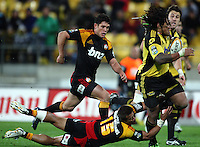 Tim Nanai-Williams tries to bring down Hurricanes second five Ma'a Nonu during the Super 14 rugby match between the Hurricanes and Chiefs at Westpac Stadium, Wellington, NewZealand on Saturday, 1 May 2010. Photo: Dave Lintott / lintottphoto.co.nz