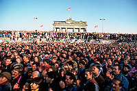 Thousands of people rushed to the Berlin Wall in the first few days after the opening of the Wall on November 9th, 1989.