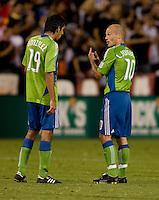 Freddie Ljungberg, Leonardo Gonzalez. The Seattle Sounders defeated DC United, 2-1, to win the 2009 Lamr Hunt U.S. Open Cup at RFK Stadium in Washington, DC.