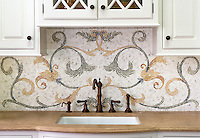 This custom kitchen features a handmade Tamsin mosaic backsplash shown in Calacatta Tia, Verde Luna, Verde Alpi, Giallo Reale, Renaissance Bronze, Rosa Verona, Spring Green, Blue Macauba and Blue Bahia from New Ravenna.<br />