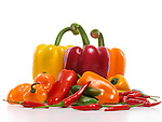 Variety of sweet and hot peppers, red, yellow, orange sweet peppers, Jalapeno, Cubanelle, Thai peppers, Scotch Bonnet pepper, mini sweet peppers. Food still life isolated on white background.