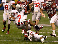 Jerico Nelson of Arkansas tackles Jordan Hall of Ohio State during the game during 77th Annual Allstate Sugar Bowl Classic at Louisiana Superdome in New Orleans, Louisiana on January 4th, 2011.  Ohio State defeated Arkansas, 31-26.