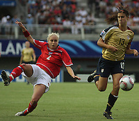 Chill·n, Chile: Americanís  forward,  Alex Morgan(L) goes for the ball along with Stephanie Hougton(R) England¥s team, during the  quarters-finals match, of the Fifa U-20 Womens World Cup the at Nelson Oyarz˙n stadium in Chill·n, on November 30, 2008. Photo by Grosnia / ISIphotos.com