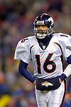 17 December 2005: Denver Broncos quarterback Jake Plummer walks back to the huddle facing the Buffalo Bills at Ralph Wilson Stadium in Orchard Park, NY. The Broncos defeated the Bills 28-17. .Mandatory Photo Credit: Ed Wolfstein