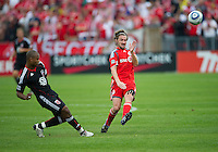 11 September 2010: D.C. United defender Julius James #21and Toronto FC forward Mista #10 in action during a game between DC United and Toronto FC at BMO Field in Toronto..DC United won 1-0..