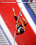A pole vaulter competes in the U.S. Olympic Track and Field Trials held at the Los Angeles Coliseum in June 1984.
