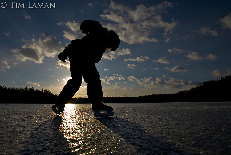 A 6-year-old boy ice skating on Walden Pond, Massachusetts