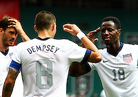 WASHINGTON, DC - June 02 2013: USA MNT v Germany MNT in the US Soccer Centennial match at RFK Stadium, in Washington DC.Clint Dempsey with Eddie Johnson (18) after his first goal. USA won 4-3.