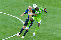 Conor Casey (6) of the Philadelphia Union goes up for a header with Djimi Traore (19) of the Seattle Sounders. The Philadelphia Union and the Seattle Sounders played to a 2-2 tie during a Major League Soccer (MLS) match at PPL Park in Chester, PA, on May 4, 2013.
