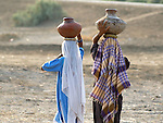 Women carrying water in the Sindh River valley in Pakistan.
