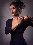 Beautiful black woman with a veil holding a katana sword in her hands