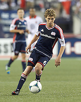 New England Revolution midfielder Scott Caldwell (6) dribbles. In a Major League Soccer (MLS) match, the New England Revolution (blue) tied D.C. United (white), 0-0, at Gillette Stadium on June 8, 2013.