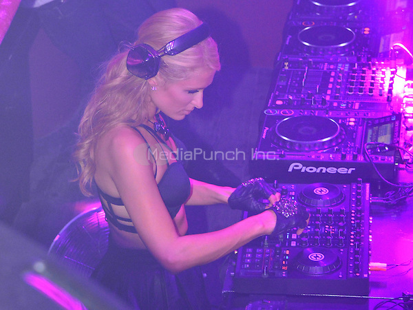 Ibiza. August 8th 2013. Exclusive look inside Club Amnesia during Paris Hilton's &quot;Foam and Diamonds&quot; party night. <br /> Paris Hilton took place behind decs at 3:00AM to rock the club Paris style<br /> A happy Paris was seen singing, jumping, dancing and drinking on her own special night<br /> Credit: BSP/insight media /MediaPunch Inc. ***FOR USA ONLY***