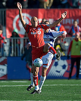 11 April 2009:  FC Dallas defender George John #14 and Toronto FC forward Danny Dichio #9 in action during an MLS game at BMO Field in Toronto between FC Dallas and Toronto FC. The game ended in a 1-1 draw.