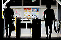 Tokyo, Japan - Two men exit out of the ticket gates at Shinjuku Station. Morning commuters typically spend over one hour on the train going to work. Trains are usually so packed that train platform staff have to push commuters to fit in the train so that the doors can close shut. (Photo by Yumeto Yamazaki/AFLO)
