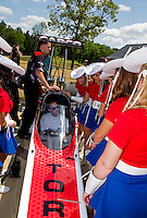 Apr 22, 2014; Kilgore, TX, USA; NHRA top fuel dragster driver Steve Torrence sits in his car as he talks to the Kilgore College Rangerettes at the Torrence estate. Mandatory Credit: Mark J. Rebilas-USA TODAY Sports