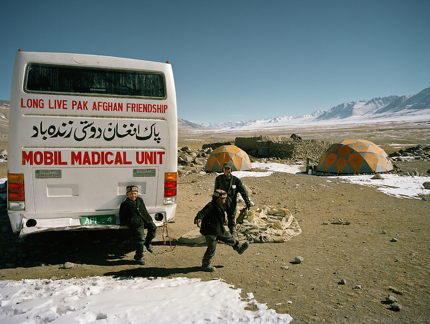 A failed Afghanistan-Pakistan joined project: a bus equipped like a portable clinic / hospital, that was driven with special authorization (over the guarded border), across the flat expanse on the Tajikistan side into Afghanistan Little Pamir, to the Khan camp of Qyzyl Qorum. Getting nurses and doctor to stay year long in the Afghan Pamir proved impossible and the bus was left abandonned to rot.